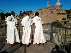 Friars watching the Roman Forum in Rome