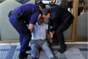 Giorgos Chatzifotiadis, 77, broke down in tears after visiting four banks in an attempt to withdraw his wife's pension of 120 euros. He became a symbol of the distress of the Greek people (AFP: Sakis Mitrolidis)
